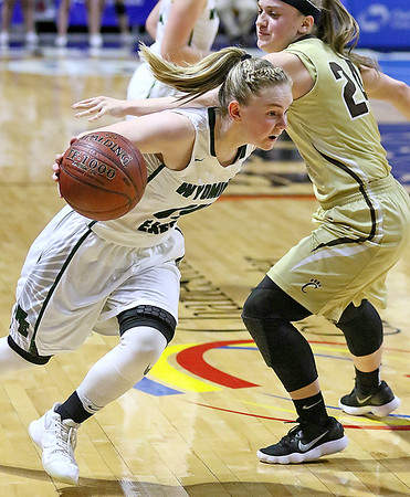 (Brad Davis/The Register-Herald) Wyoming East's Jazz Blankenship speeds around Lincoln's Gracey Lamm Wednesday afternoon at the Charleston Civic Center.