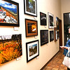 "Jackie Sauls, of Crab Orchard, looks over the West Virginia Photographers ""Capturing our Mountain State"" gallery on display in the Beckley Newspapers lobby. This gallery will officially open this even with a free open house reception with refreshments from 5 p.m. to 7 p.m. The exhibit, which features 40 photographers from across the Mountain State, was originally created in 2016 to honor the 40th anniversary of the West Virginia CultureCenter building on the State Capitol Complex in Charleston. The photographs include landscapes of the state, local residents and more. The Register-Herald is located at 801 N. Kanawha Street in Beckley.<br /> (Rick Barbero/The Register-Herald)"