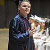 (Brad Davis/The Register-Herald) Independence grad C.J. Taylor gestures to friends and family in the stands after receiving his diploma Saturday morning at the Beckley-Raleigh County Convention Center.
