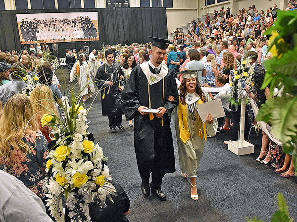 (Brad Davis/The Register-Herald) Graduating Westside seniors make their way out of the gym and into the world after receiving their diplomas during the school's 2018 Commencement Ceremony Sunday afternoon in Clear Fork.