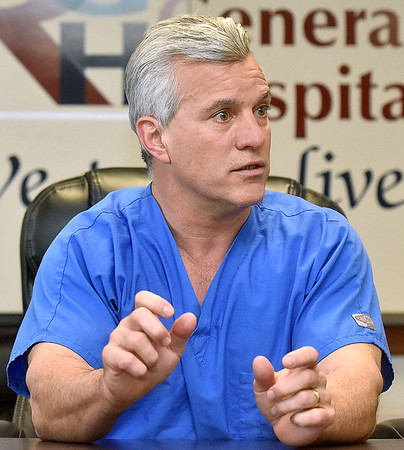 "(Brad Davis/The Register-Herald) Dr. Scott Killmer, a surgeon at Raleigh General Hospital, describes working with the da Vinci robotic surgical system, a.k.a. ""The Robot"" works during a Register-Herald visit to the hospital Friday afternoon. He just completed his 500th surgery using the da Vinci system."