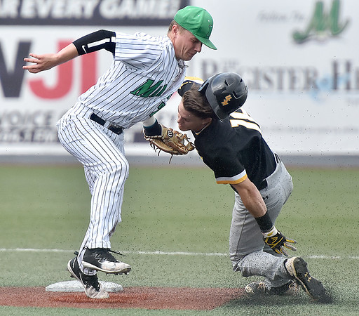 (Brad Davis/The Register-Herald) Marshall shortstop Geordon Blanton tags out stealing Southern Miss baserunner Cole Donaldson, but accidentally catches him in the face in the process and knocking Donaldson out of the game for precautionary concussion observation Thursday afternoon at Linda K. Epling Stadium.