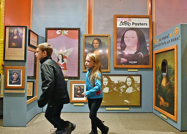 """(Brad Davis/The Register-Herald) A pair of youngsters scurry around the Youth Museum as they explore its new exhibit, """"Framed, Step into the Art,"""" November 24."""