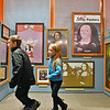 "(Brad Davis/The Register-Herald) A pair of youngsters scurry around the Youth Museum as they explore its new exhibit, ""Framed, Step into the Art,"" November 24."