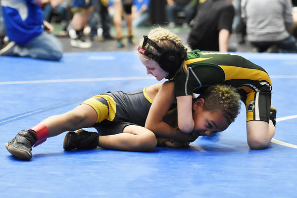 Eastern Greenbrier's Bella Arbogast wrestles Cougars Zeon Ward during their wrestling match as part of the WVYWA State Tournament in Beckley Saturday. Arbogast won the match. (Chris Jackson/The Register-Herald)