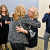 (Brad Davis/The Register-Herald) Retiring New River Community and Technical College employee Libby Belcher (middle) is congratulated by friends, family and colleagues on more than 20 years of service during a reception Wednesday afternoon.