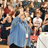 (Brad Davis/The Register-Herald) Sherrie Hunter, Director of Education at the Raleigh County Solid Waste Authority, leads students and faculty at Trap Hill Middle School, this year's champion in the annual School Recycling Program, in pledging to keep the environment clean during a ceremony at the school Wednesday afternoon in Glen Daniel.