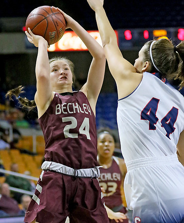 (Brad Davis/The Register-Herald) Woodrow Wilson's Liz Cadle drives and scores as Parkersburg South's Allie Taylor defends Wednesday afternoon at the Charleston Civic Center.