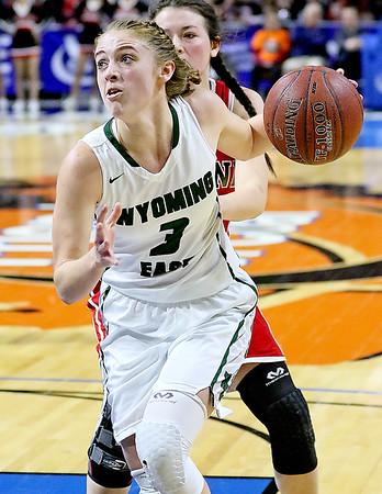 (Brad Davis/The Register-Herald) Wyoming East's Kara Sandy drives to the basket as Wayne's Lakyn Adkins defends Friday morning at the Charleston Civic Center.