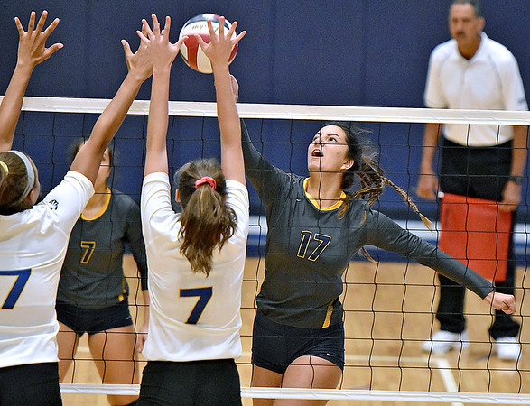 (Brad Davis/The Register-Herald) WVU Tech's Ana Alonso Olea rushes into a spike attempt as Midway defenders Candi Staten, left, and Madi Eberst try to block it Saturday afternoon in the Van Meter Gymnasium.