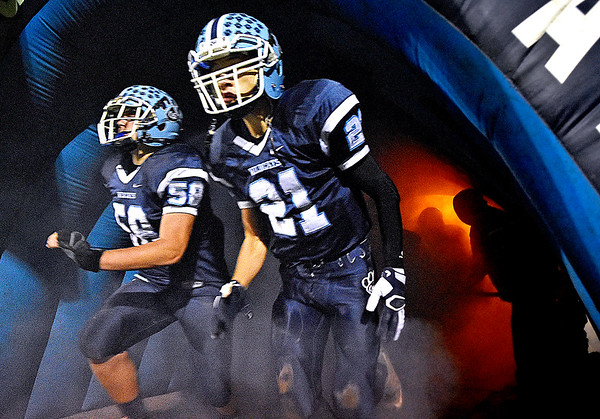 (Brad Davis/The Register-Herald) The Wildcats rush onto the field through a foggy tunnel for their home game against Summers County Friday night in Meadow Bridge.