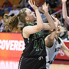 (Brad Davis/The Register-Herald) Wyoming East's Brooke Russell drives and scores as North Marion's Abbie Denham defends Saturday afternoon at the Charleston Civic Center.