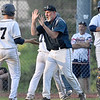 (Brad Davis/The Register-Herald) Shady Spring head coach David Shaw congratulates his players following Kenneth Sizemore's diving run scored off a squeeze play Wednesday evening in Shady Spring.