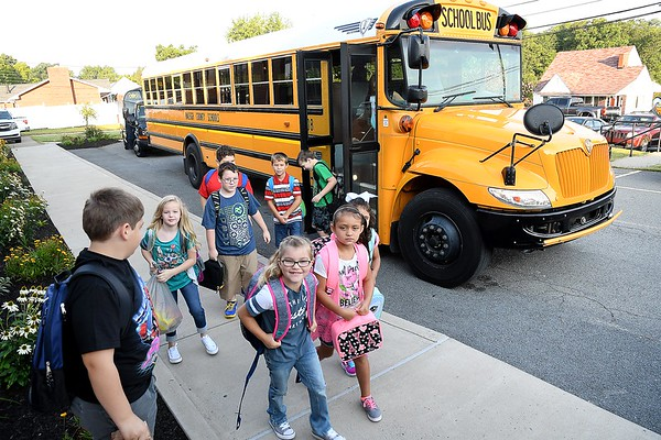 Students get off the bus at Crescent Elementary School in Beckley Wednesday morning for the first day of school in Raleigh County.<br /> (Rick Barbero/The Register-Herald)