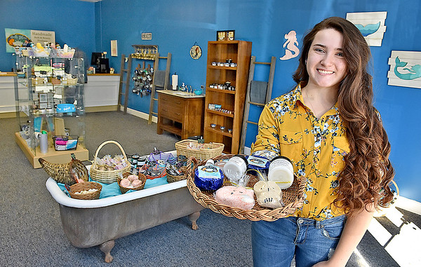 (Brad Davis/The Register-Herald) Young owner Piper Burgess poses for a quick photo inside Bath Bliss, located at 1320 South Eisenhower Drive between Vapor Vault and Brickhouse Cardio, Thursday afternoon.