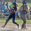 (Brad Davis/The Register-Herald) Greenbrier West's Lilly Bennett slips around Summers County catcher Michelle Shrewsbury to score a run  Wednesday evening at Western Greenbrier Middle School.