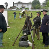 (Brad Davis/The Register-Herald) Union soldiers, a.k.a. Stephen Pavey, left, and Patrick Parker, far right, fraternize with Confederate counterpart Rick Henry as they garrison the area around Wildwood House (background), the former home of General Alfred Beckley, during Founder's Day festivities Saturday afternoon.