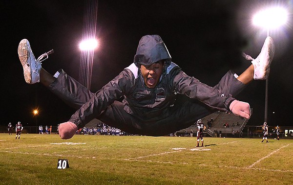Shawn Robertson, cheerleader for Woodrow Wilson, cheering during game against Capitol at Van Meter Stadium in Beckley Friday Night.<br /> (Rick Barbero/The Register-Herald)