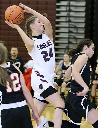(Brad Davis/The Register-Herald) Woodrow Wilson's Liz Cadle drives and scores on the break as PikeView's Hope Craft, lower right, overpursues Thursdsay night in Beckley.
