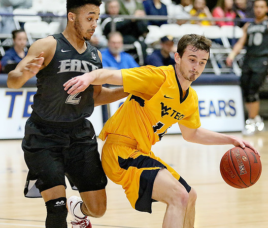 (Brad Davis/The Register-Herald) WVU Tech's Cole Schoolcraft tries to hold off IU-East defender Charles Peterson as he moves the ball up the court Saturday afternoon at the Beckley-Raleigh County Convention Center.