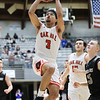 Oak Hill's Abe Farrow (3) goes up for a layup during the first half of their basketball sectional championship against Westside Thursday in Beckley. (Chris Jackson/The Register-Herald)