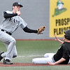 (Brad Davis/The Register-Herald) Wyoming East third baseman Tanner Hall gets the throw from catcher Eric Hoosier in a perfect position to tag advancing Oak Hill baserunner Kade Legg Friday evening at Linda K. Epling Stadium.