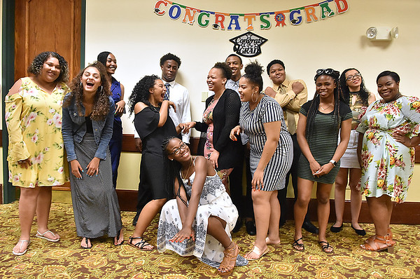 (Brad Davis/The Register-Herald) High school graduates from the first ever class to participate in the BEAUTY (Black Educators Are United Totally - Yes!) tudoring and mentoring program pose for a quick photo during the opening moments of a banquet celebrating their achievments Saturday night inside the Mountaineer Lounge at Country Inn & Suites.
