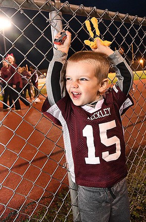 Jackson Stafford, 3, son of Ryan and Bethany Stafford, cheering on the Woodrow Wilson Flying Eagles during game against Capitol at Van Meter Stadium in Beckley Friday Night.<br /> (Rick Barbero/The Register-Herald)
