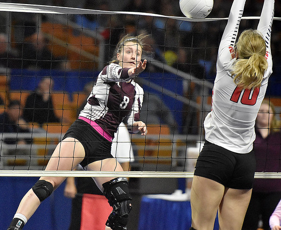 (Brad Davis/The Register-Herald) Woodrow Wilson's Bryce Knapp spikes the ball as University's Malia Richardson tries to block during State Volleyball Tournament action Friday evening at the Charleston Civic Center.
