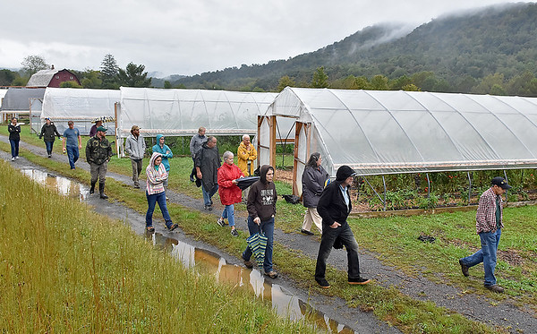 (Brad Davis/The Register-Herald) A group of visitors tour an array of high tunnels, the primary method of farming being used and developed on the grounds of Sprouting Farms during a WV CRAFT (Collaborative Regional Alliance for Farmer Training) open house style event Sunday afternoon in Talcott.
