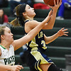 Greenbrier West's (3) goes up for a layup as Fayetteville's (10) tries to block during their basketball game Tuesday in Fayetteville. (Chris Jackson/The Register-Herald)