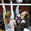 (Brad Davis/The Register-Herald) Woodrow Wilson's Adrian Coalson rips a spike as University's Avary Hamilton tries to block during State Volleyball Tournament action Friday evening at the Charleston Civic Center.