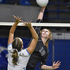 (Brad Davis/The Register-Herald) Independence's Lexi Bolen spikes the ball as Oak Glen's McKayla Goodwin tries to block it during State Volleyball Tournament action Friday morning at the Charleston Civic Center.