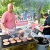 (Brad Davis/The Register-Herald) Grillmaster Justin Jones with Joey & George's Catering keeps burgers flowing for any who wanted one during Founder's Day festivites Saturday afternoon at Wildwood House.