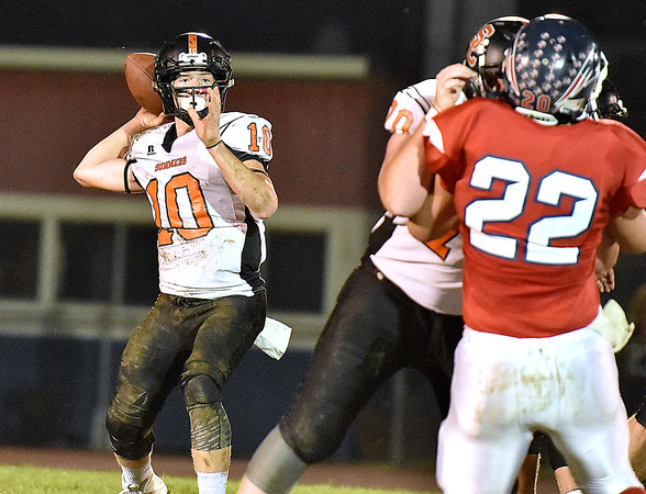 (Brad Davis/The Register-Herald) Summers County quarterback Timmy Persiani drops back to throw against Independence Friday night in Coal City.