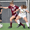 (Brad Davis/The Register-Herald) Woodrow Wilson's Logan Ragland battles for possession with Greenbrier East's Abbie Bartenslager Friday evening at the YMCA Paul Cline Memorial Soccer Complex.