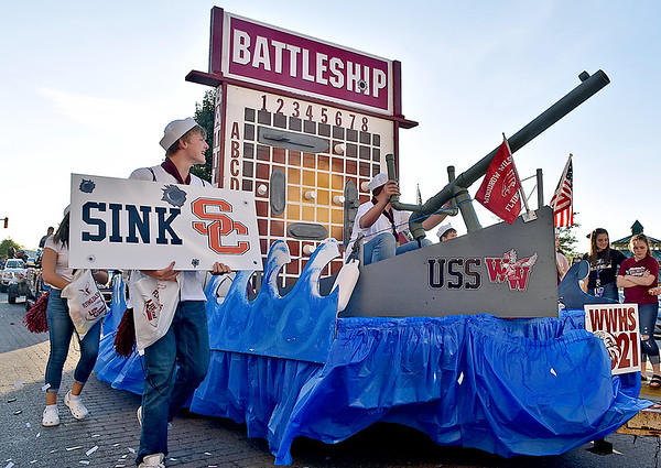 "(Brad Davis/The Register-Herald) The sophomore class ""sails"" up Neville Street in the USS Woodrow Wilson as their Battleship boardgame-themed float makes a splash during the school's homecoming parade Wednesday evening in downtown Beckley."