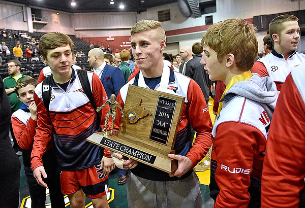 (Brad Davis/The Register-Herald) Indy wrestlers collect the school's fifth straight team title prior to taking the team photo during State Wrestling Tournament action Saturday night at the Big Sandy Arena.