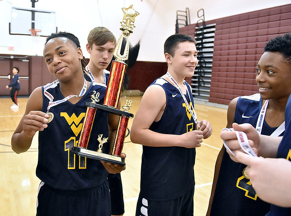 (Brad Davis/The Register-Herald) The WV Elite (Bluefield) celebrate their eighth grade Biddy Buddy Championship game victory against VSN Sunday afternoon at Woodrow Wilson High School.