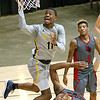 (Brad Davis/The Register-Herald) WVU Tech's Thomas Collins drives and scores through IU-Kokomo defender Durante Lee during the Golden Bears' win over the Cougars Saturday night at the Beckley-Raleigh County Convention Center.