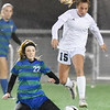 Winfield's Peyton Frohnapfel (15) gets past Robert C. Byrd's Madison Smith (22) during their Class AA/A semifinal game in Beckley Friday. (Chris Jackson/The Register-Herald)