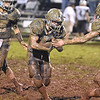 (Brad Davis/The Register-Herald) Meadow Bridge ball carrier Caleb Richmond trudges through the mud against Valley Friday night in Meadow Bridge.