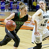 (Brad Davis/The Register-Herald) Wyoming East's Kara Sandy drives around North Marion's Abbie Denham Saturday afternoon at the Charleston Civic Center.