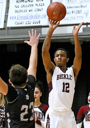 (Brad Davis/The Register-Herald) Woodrow Wilson's Ty Walton shoots from three-point range as Riverside's Mark Saitos defends Wednesday night at the Beckley-Raleigh County Convention Center.