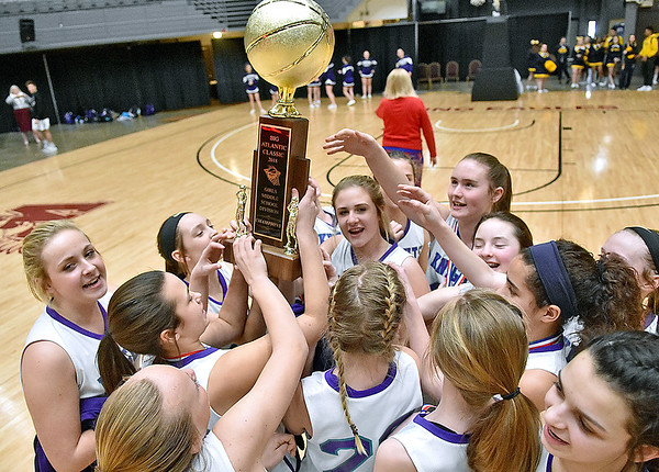 (Brad Davis/The Register-Herald) Eastern Greenbrier celebrates with the trophy after winning the Middle School Girl's championship game at the Big Atlantic Classic Wednesday afternoon at the Beckley-Raleigh County Convention Center.