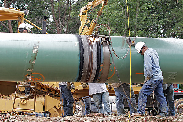 Workers for the Mountain Valley Pipeline weld together sections of pipe near Lindside in Monroe County Wednesday. (Jenny Harnish/The Register-Herald)
