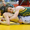 (Brad Davis/The Register-Herald) Greenbrier East's Landon Hoover takes on Washington's Dominic Emswiler in a 106-pound weight class matchup during state wrestling tournament action Thursday night at Huntington's Big Sandy Arena. East's Hoover won the match.