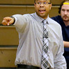 (Brad Davis/The Register-Herald) Wyoming East boys basketball coach Derek Brooks instructs his team against Shady Spring January 12 in New Richmond.