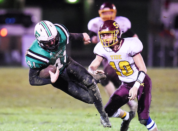 Fayetteville's Calvin Endicott (41) is tackled by Sherman's Seth Rinchich (10) during their high school football game Friday in Fayetteville. (Chris Jackson/The Register-Herald)