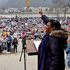 (Brad Davis/The Register-Herald) Becky Pringle, Vice President of the National Education Association, fires up the massive crowd of teachers and other state workers who braved cold and rainy conditions during her speech at a rally at the State Capitol Complex Saturday afternoon.